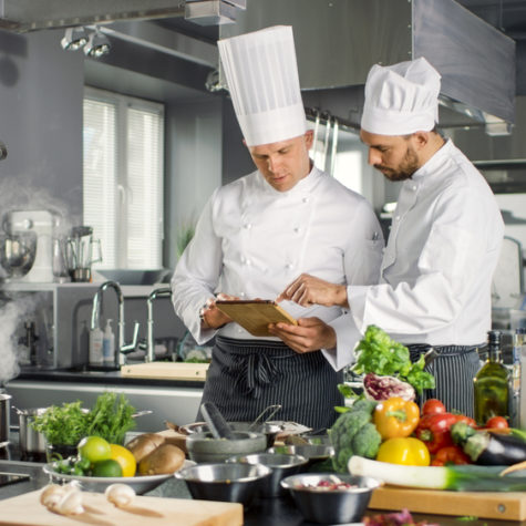Two,Famous,Chefs,Discuss,Their,Video,Blog,While,Using,Tablet